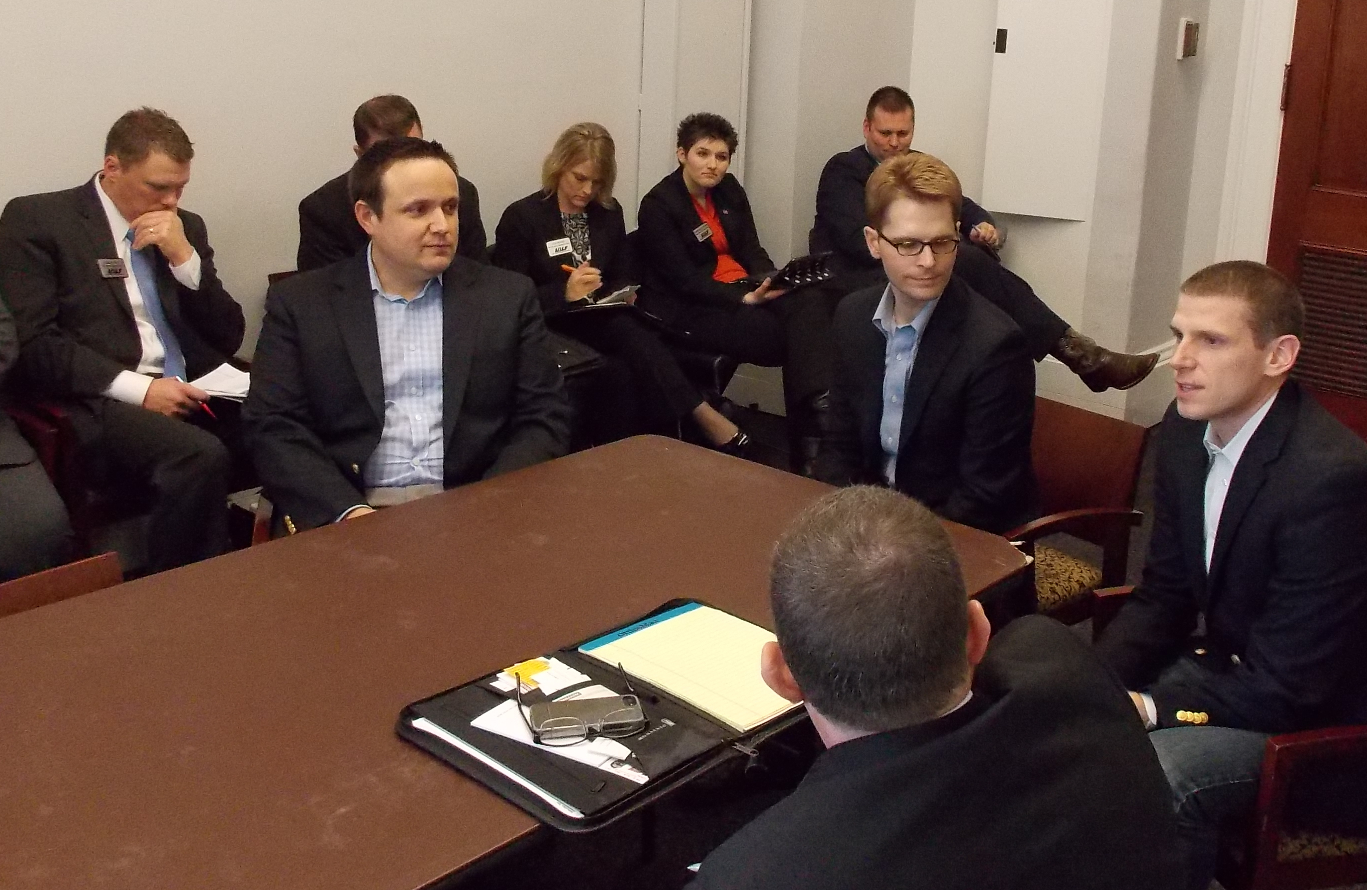 Bart Fisher (left), Matt Shertz, and Bobby Frederick discuss House Agriculture Committee business with the class.