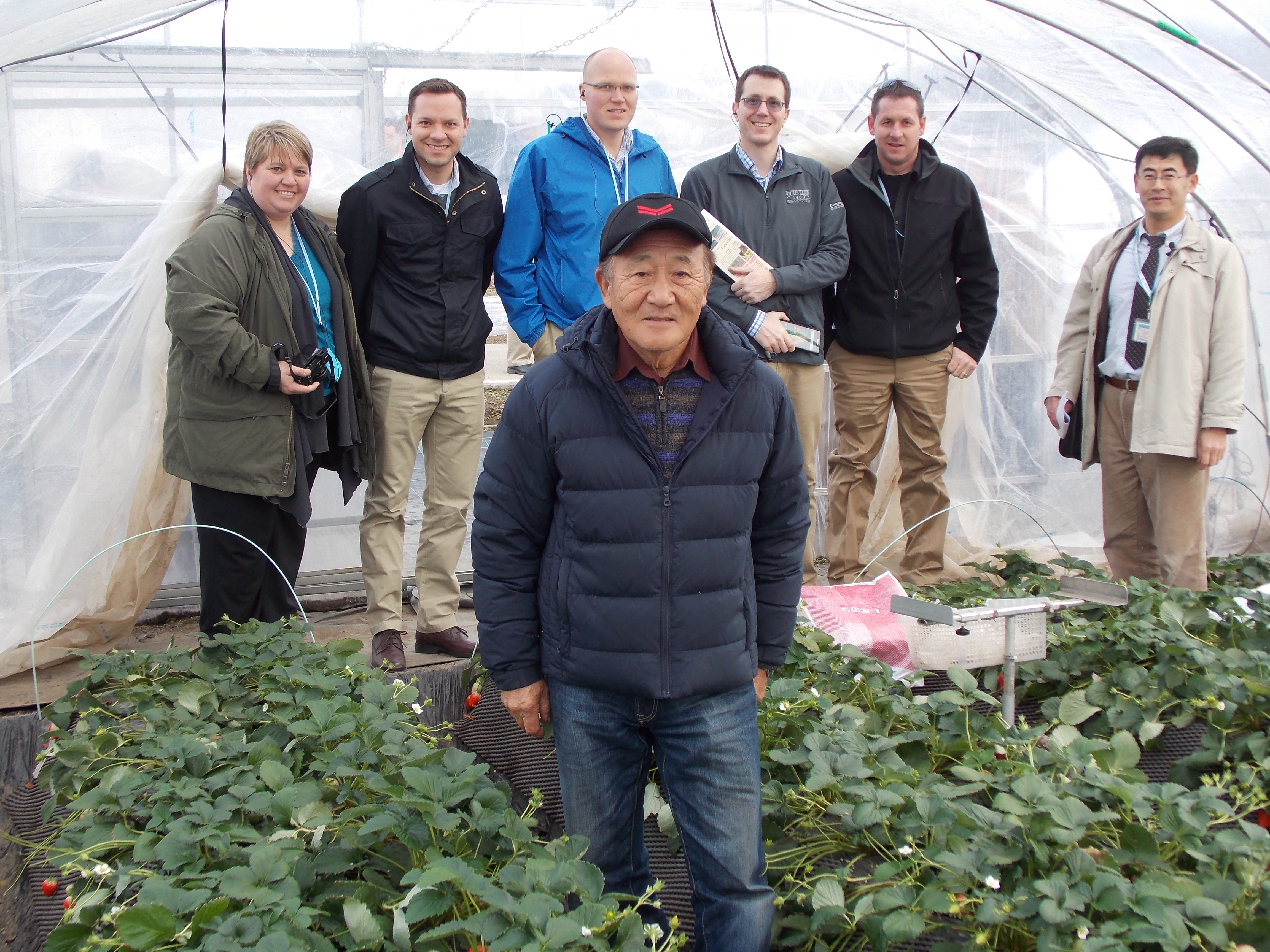 Several members of the Class of 2016 pose for a photo with Mr. Nihei in one of his greenhouses.