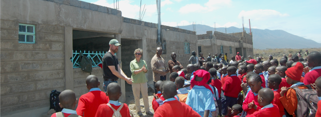 IALP graduate Brian Anderson, in center with cap, talks with grade school children in Kenya. He works with members of the East African Food Bank, a division of the Midwest Food Bank, to locate farm ground for potential soybean production. East African Food Bank has been working with a product called Tender Mercies, a high nutrition supplement available for food insecure people.